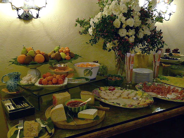 Fresh flowers on the buffet table in the restaurant at Villa le Barone