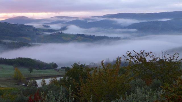 Sunrise over the Chianti hills seen from Villa le Barone