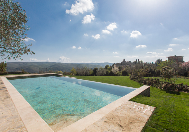 Infinity pool in travertine marble in Tuscany at hotel Villa le Barone Tuscany